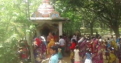 Women celebrate Savitri brata in a temple in Khaira